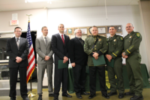 Pictured L to R: Deputy Jamey Morgan, Deputy Jordan Thomson, Deputy Ryan Carpenter, Communications Manager Frank Yost, Sgt. Jeff Leikauf, Lt. Bryan Golmitz and Lt. James Byers
